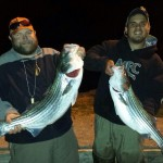 Huck and Tyler doubled up on South Holston river stripers on fly