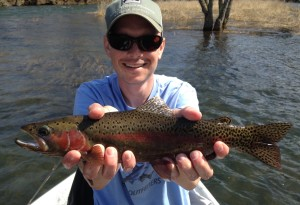 Clint caught a beautiful South Holston river rainbow while fishing with Huck