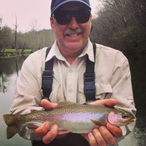 Dave with a nice Watauga river rainbow trout while fishing with Huck