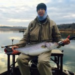 Dr. Campbell with a Boone Lake striper fly fishing with Charlie
