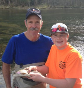Fly fishing lesson on the South Holston river grandfather and grandson