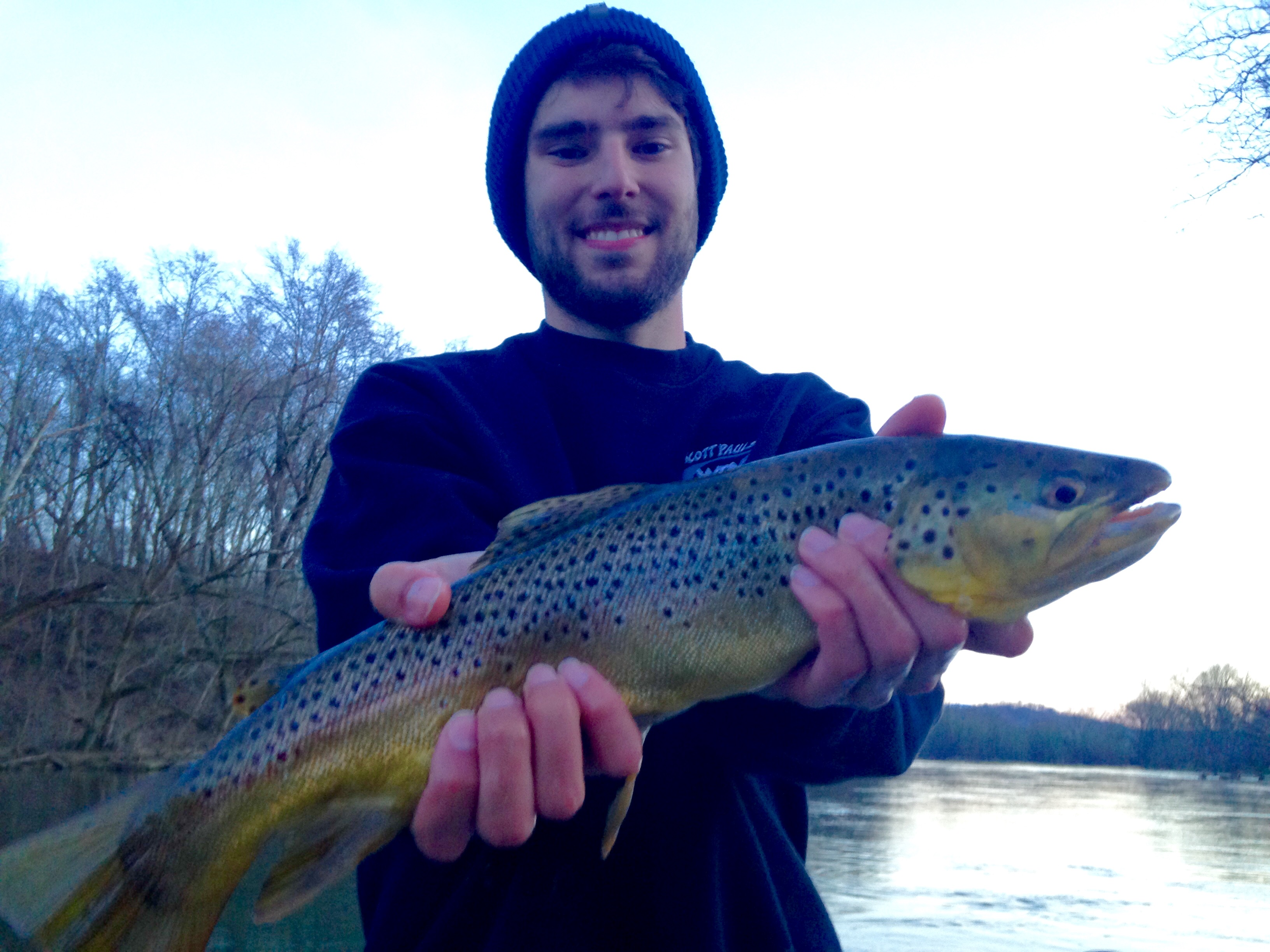 Jordan with a 20.5 inch Watauga River brown trout while fishing with Huck