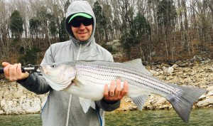 Pete with a Boone lake striper fishing with Charlie Parker