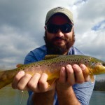 Jake with a Watauga river brown trout while fishing with Huck
