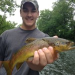 Bryson holding a nice Watauga river brown trout
