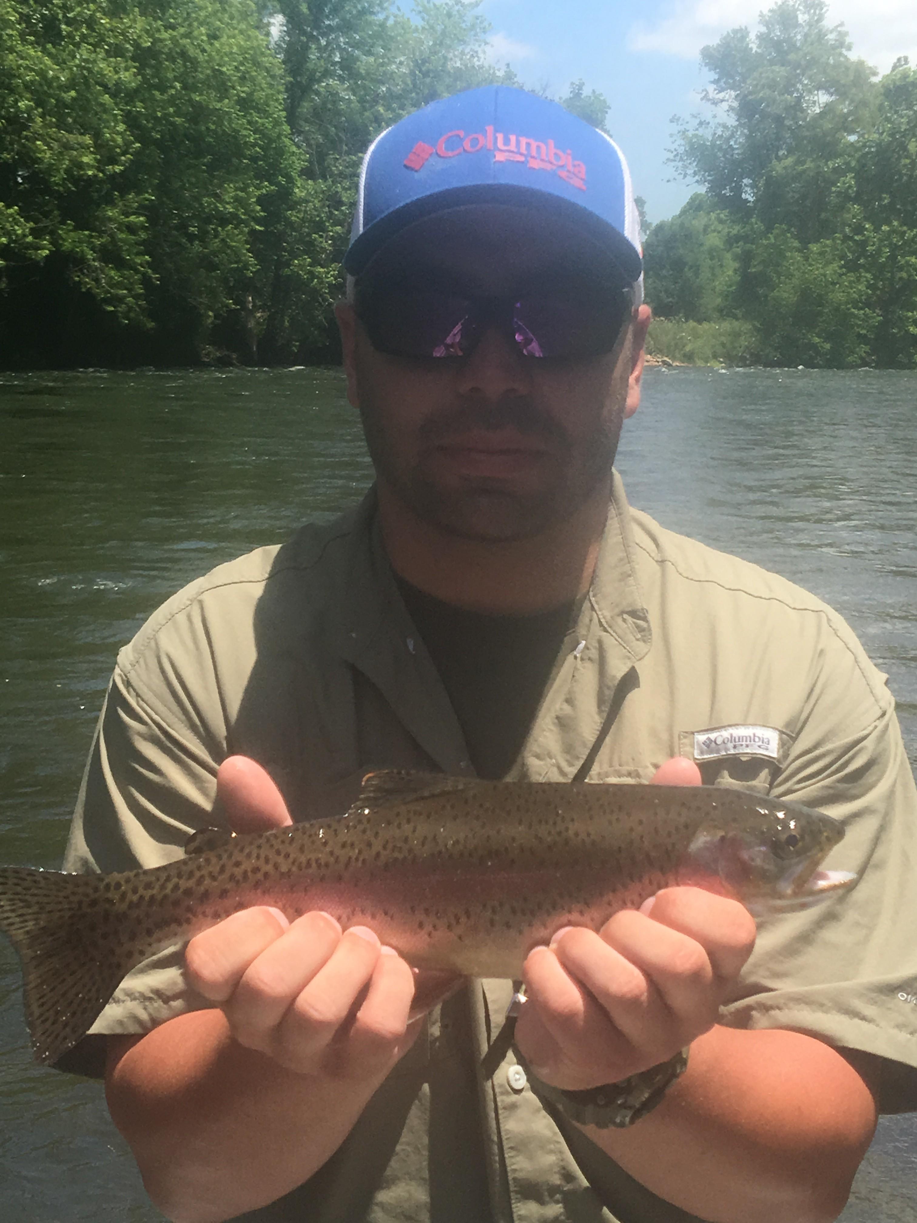 Christian with a nice Watauga river rainbow